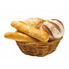 Bread loaves and baguettes in a basket