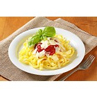 Ribbon pasta with tomato paste and Parmesan