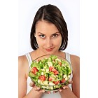 Young woman with fresh salad