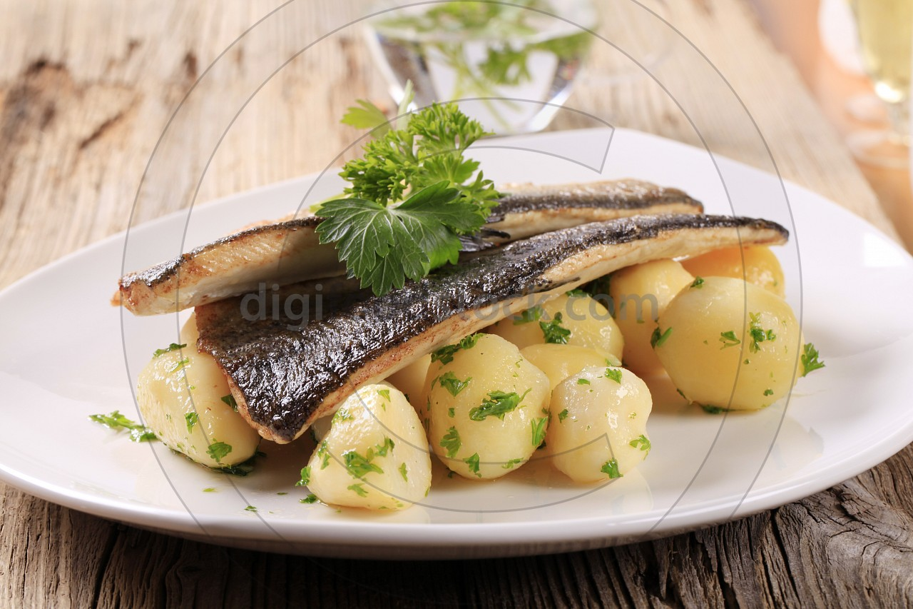 Pan fried trout fillets with potatoes