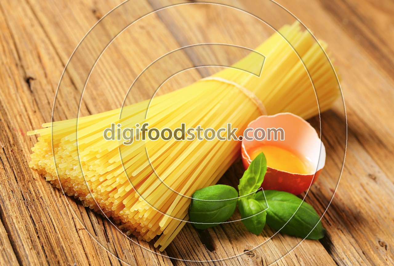 Dried spaghetti and raw egg