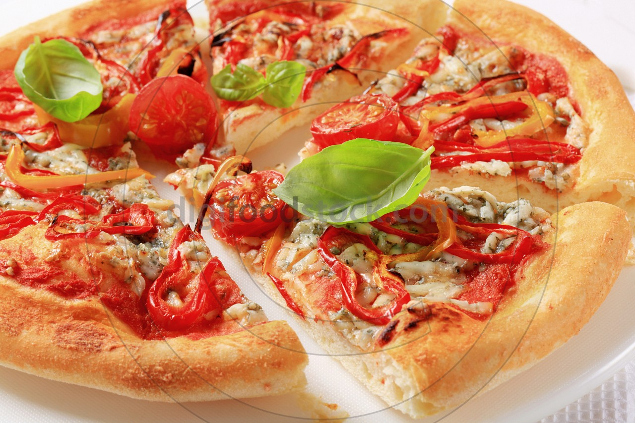 Blue cheese pizza with strips of pepper on top