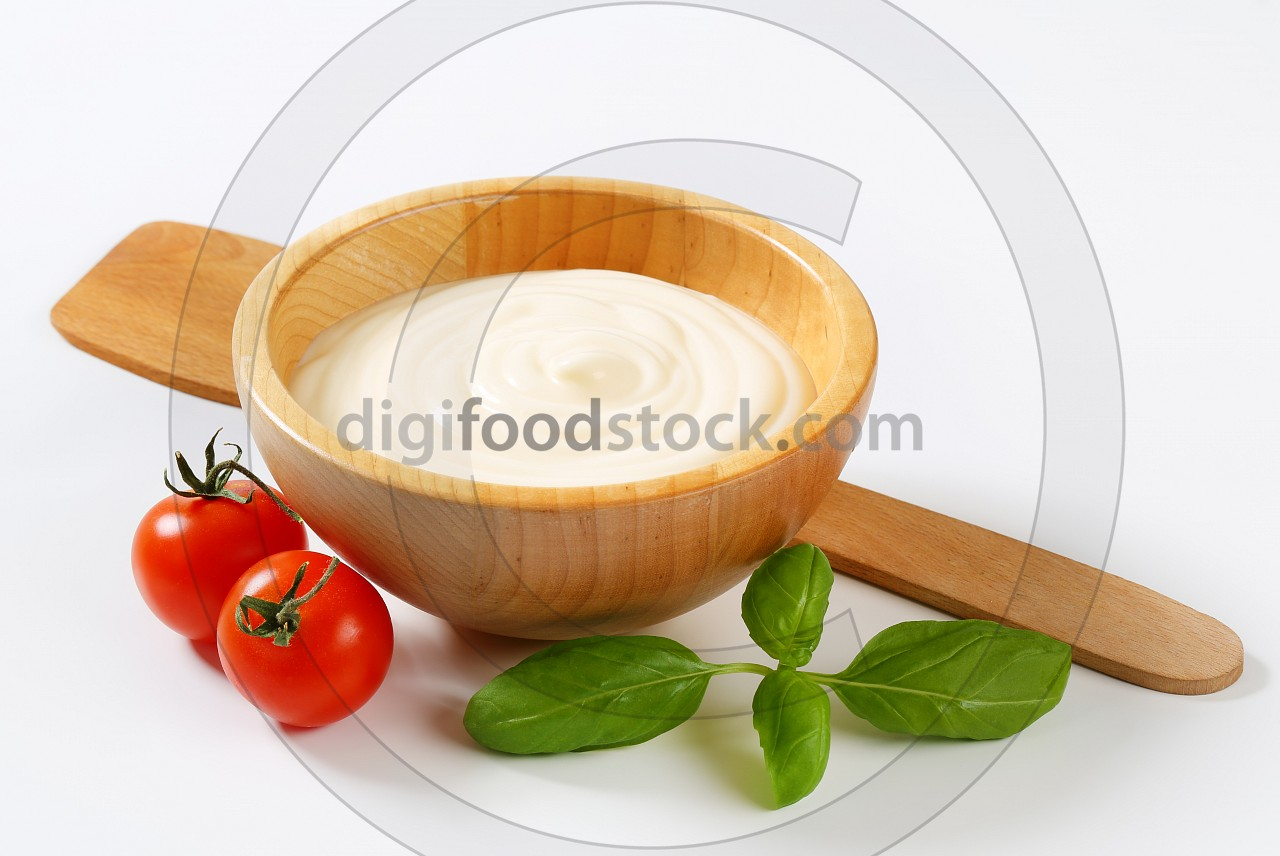 Creamy sauce in wooden bowl