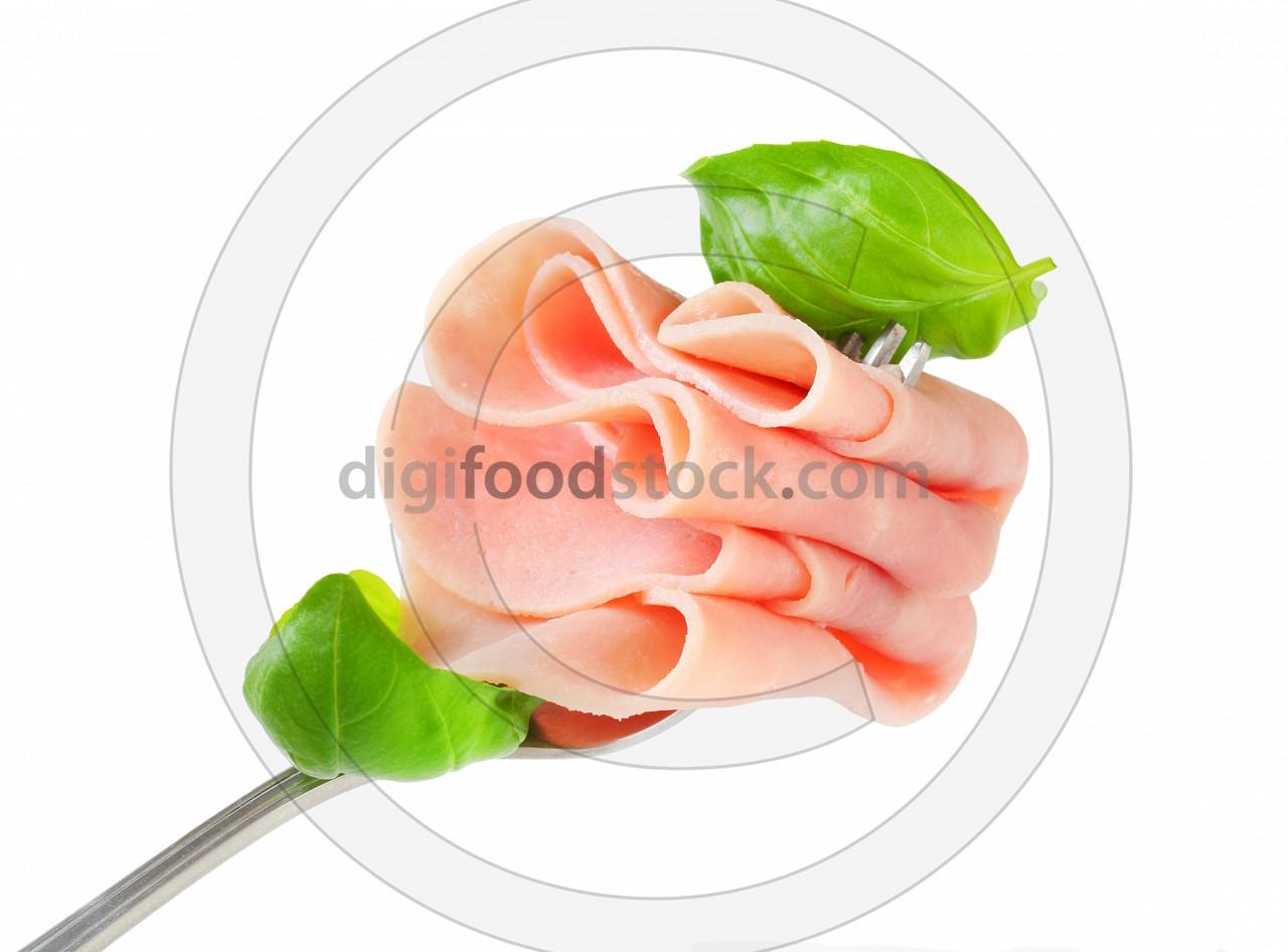 Slices of ham on fork
